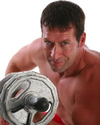 man strength training with dumbbell